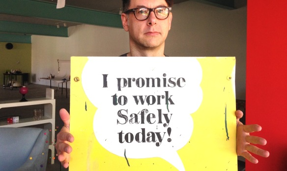 Eric Kass with sign at show